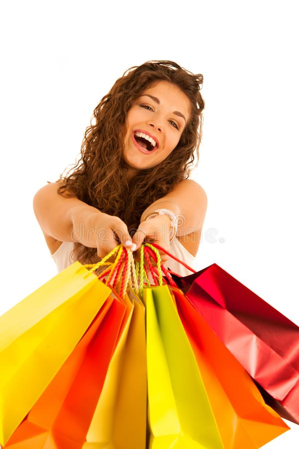 Attractive young caucasian woman with shopping bags isolated over white background stock photography