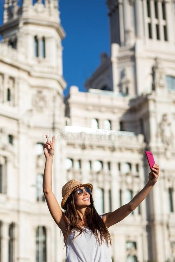 Attractive young woman taking a selfie in Madrid, Spain royalty free stock image