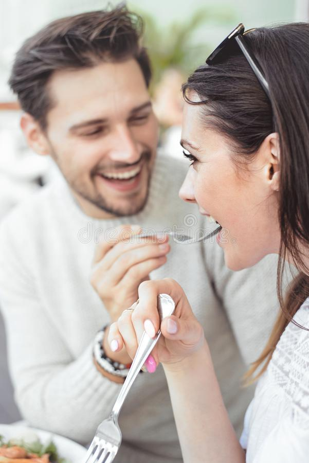 Attractive couple eating a light lunch stock photography