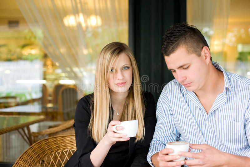 Attractive young couple enjoying beverage. royalty free stock photo