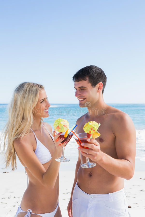 Download Attractive Young Couple Holding Cocktails Stock Photo - Image: 33053670