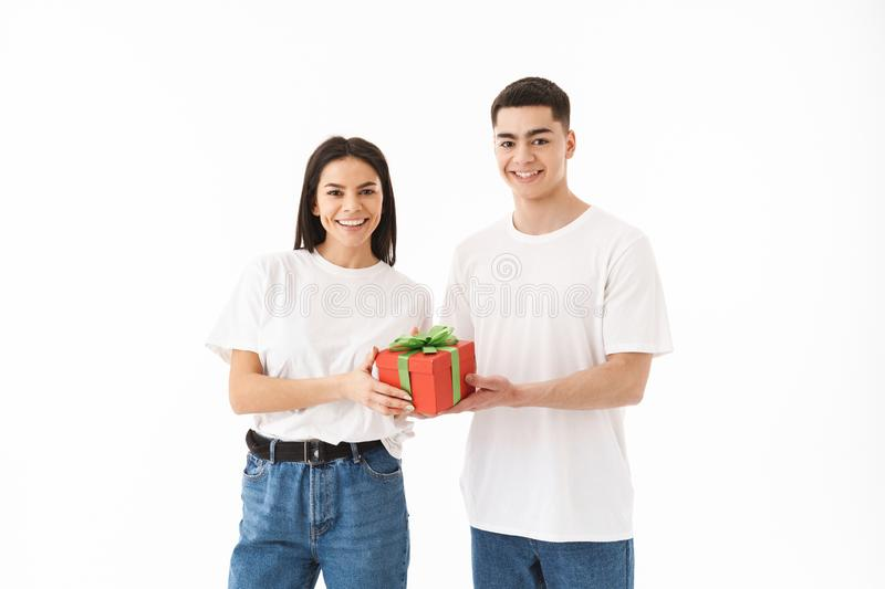 Attractive young couple standing isolated over white stock photos