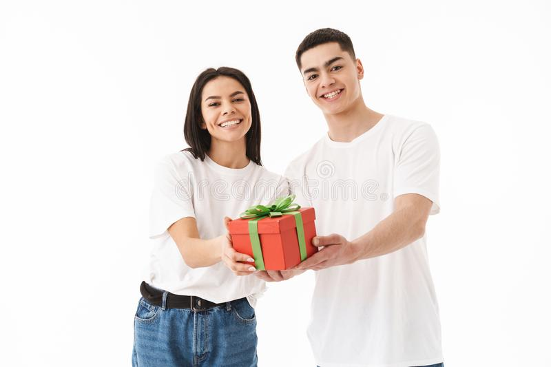 Attractive young couple standing isolated over white stock photo
