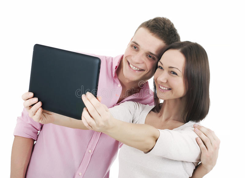 Attractive young couple taking a selfie together. Isolated on white royalty free stock image