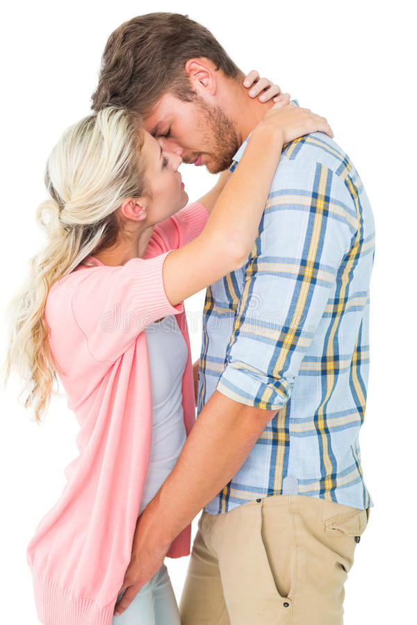 Attractive young couple about to kiss stock photos