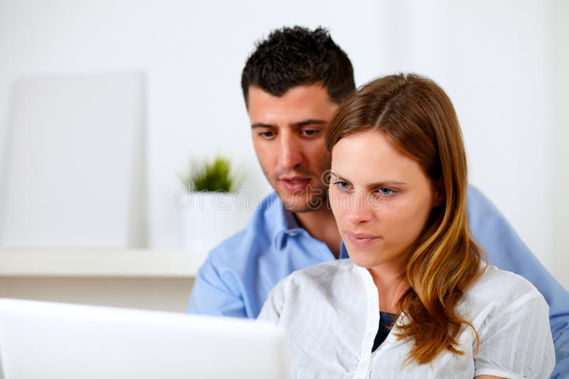 Download Attractive Young Couple Using Laptop Together Stock Photo - Image of girl, beauty: 25502812