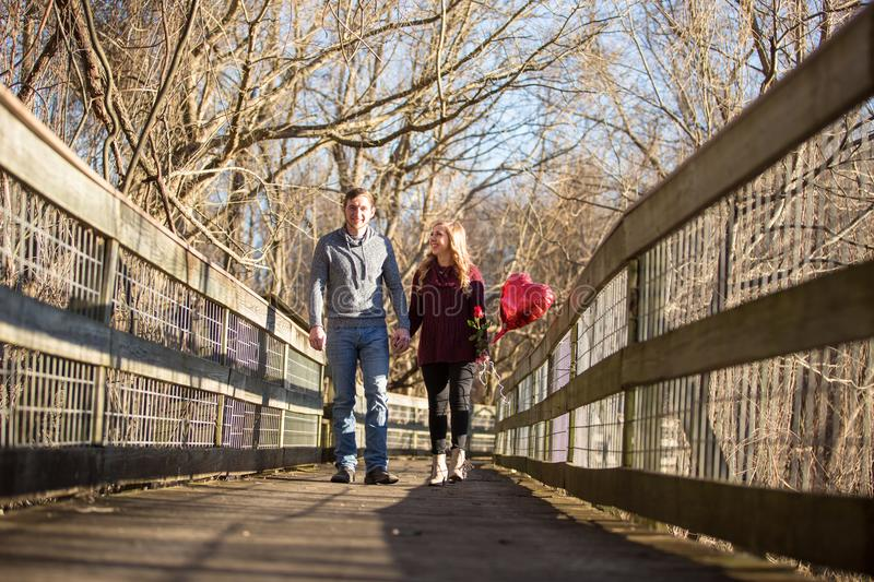 Attractive young couple walking towards the viewer royalty free stock photo