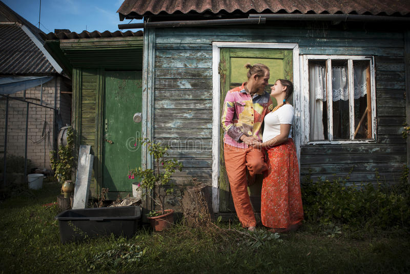Attractive young couple at wooden house stock photo