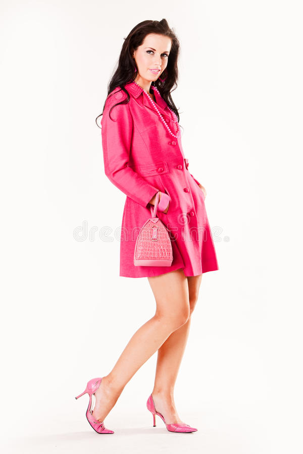 Attractive Young Fashion Model In Pink Coat Stock Photos