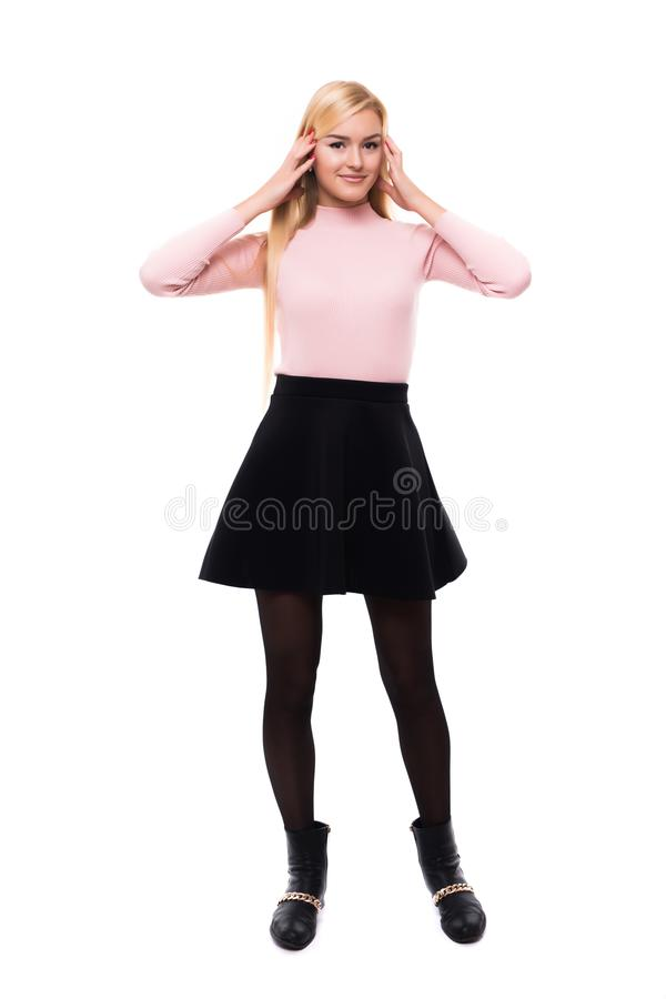 Attractive young fashion model wearing dress in studio and smiling royalty free stock image