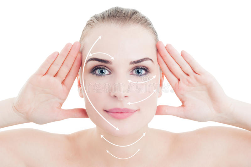 Attractive young female with arrows marks on her face royalty free stock photo