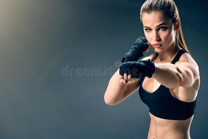 Attractive young female boxer punching alone royalty free stock photos