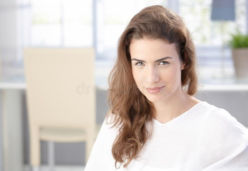 Attractive young female at home smiling stock photos