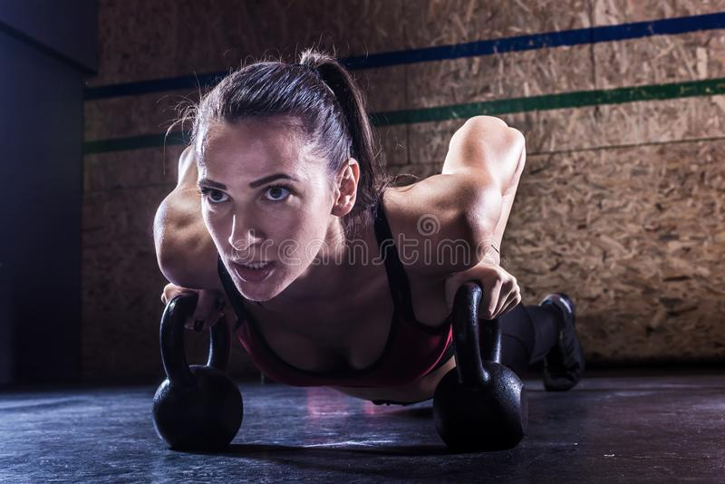 Portrait of attractive young crossfit sports women indoors. Attractive young fit sportswomen working out in gym royalty free stock photography