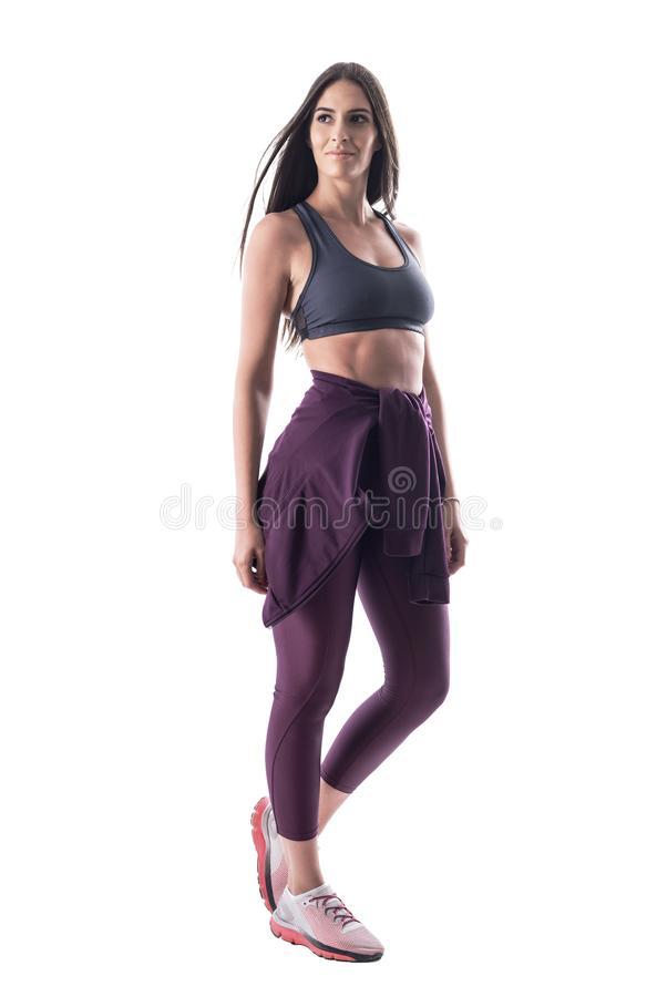 Attractive young fitness woman posing in sports clothes with perfect abs muscles. Full body isolated on white background royalty free stock photos