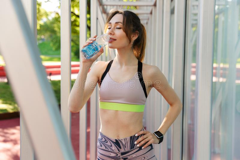 Attractive young fitness woman wearing sports clothing stock images