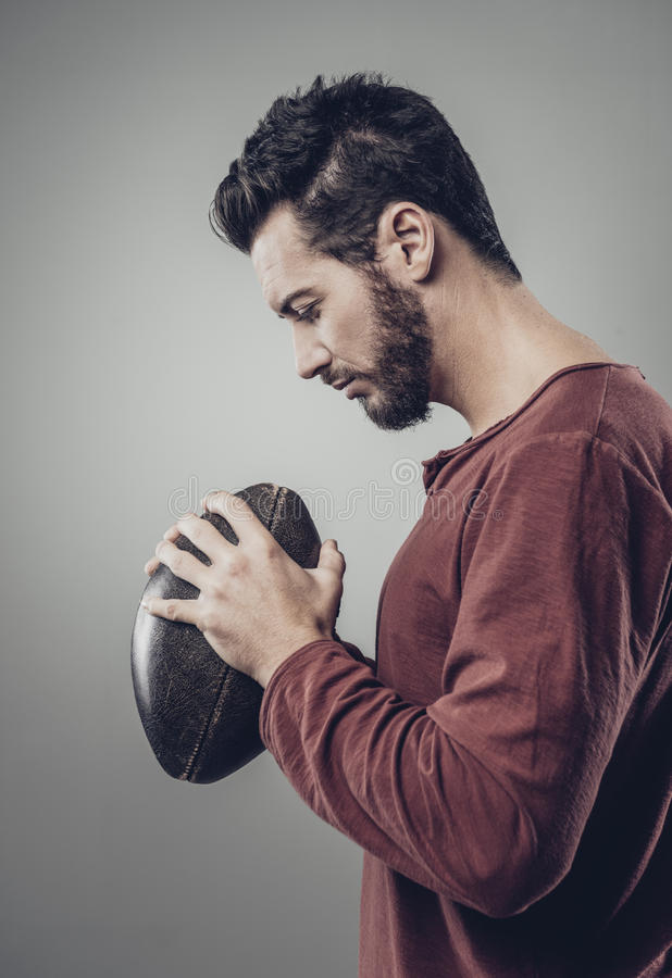 Attractive young fotball player royalty free stock photo