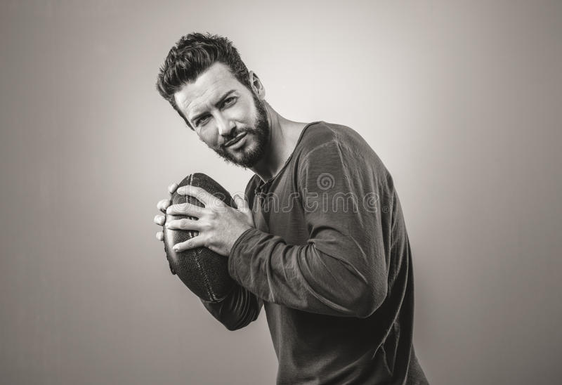 Attractive young fotball player stock images