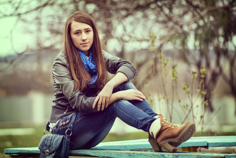 Attractive young girl enjoying a quiet moment royalty free stock images