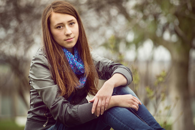 Attractive young girl enjoying a quiet moment royalty free stock photography