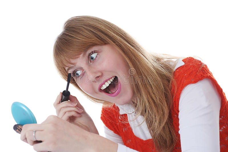 Attractive young girl holding brush stock photo