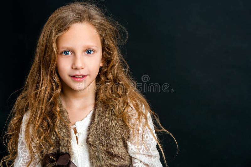 Attractive young girl with long curly hair. royalty free stock photo