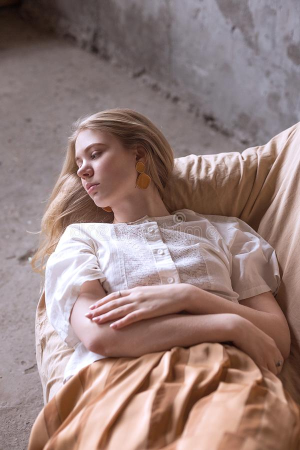 Attractive young girl lying on a couch royalty free stock photos