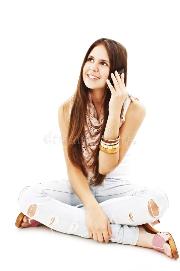 Attractive young girl making a phone call stock photos