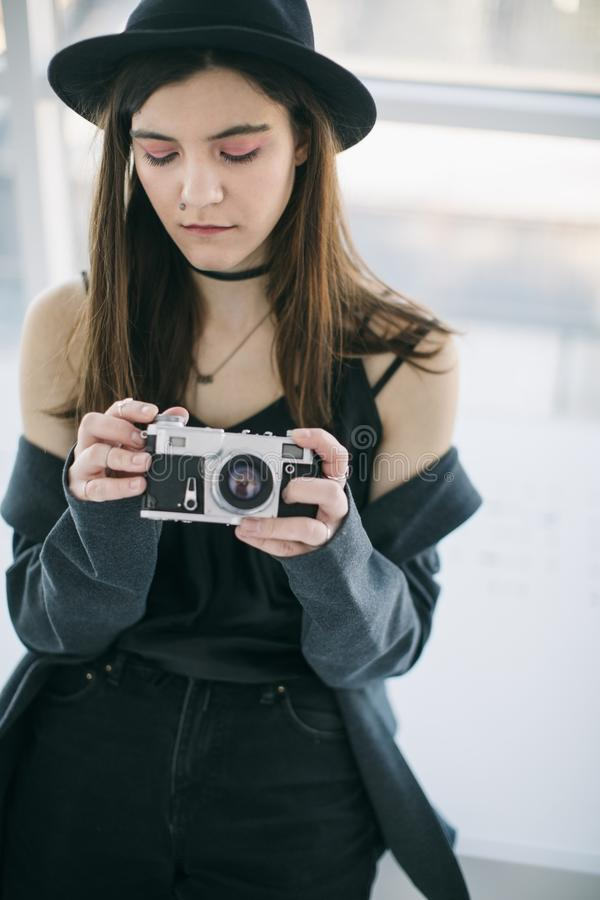 Attractive young girl photographer journalism student. Beautiful portrait. Big city lifestyle royalty free stock photos