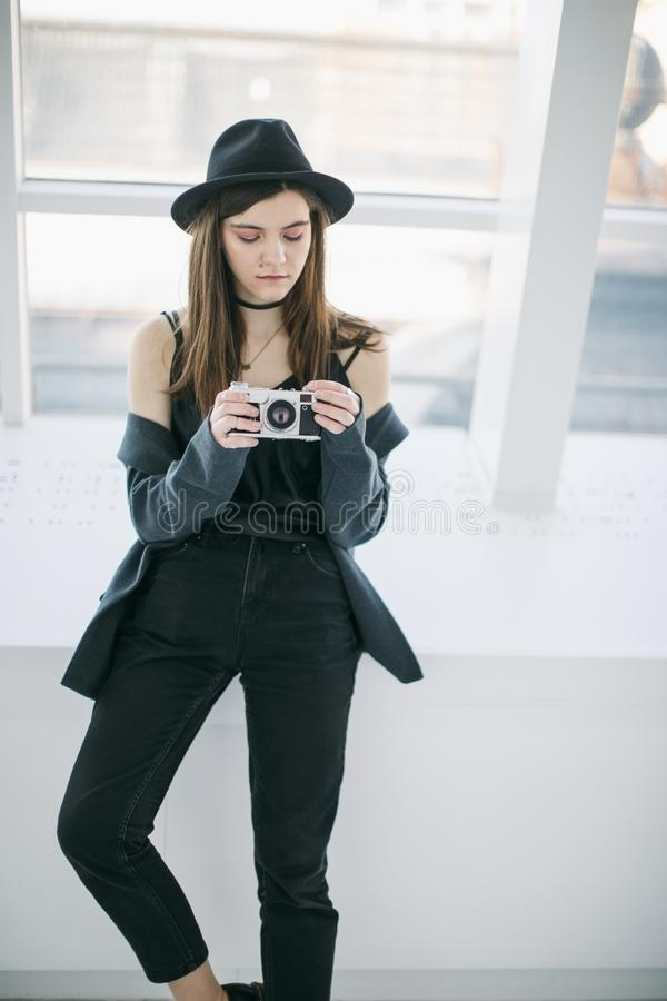 Attractive young girl photographer student. Beautiful portrait. setting the cam. Creative work stock images