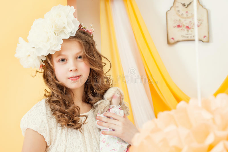 Attractive young girl posing with doll. Close-up stock image