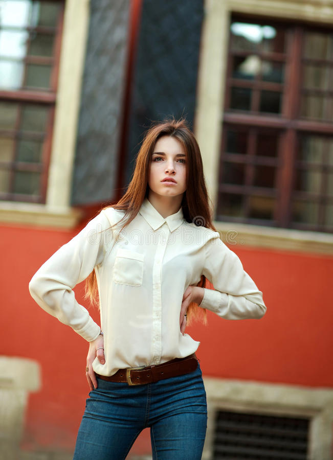 Attractive young girl posing on street of the old city royalty free stock photos