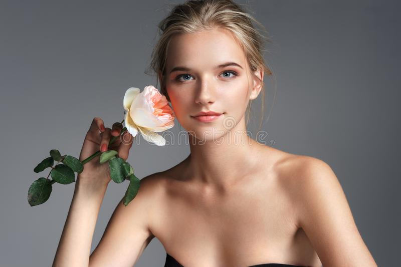 Attractive young girl with rose. royalty free stock image