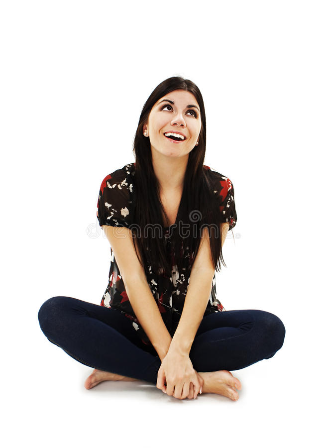 Attractive young girl sitting on the floor looking up royalty free stock photos