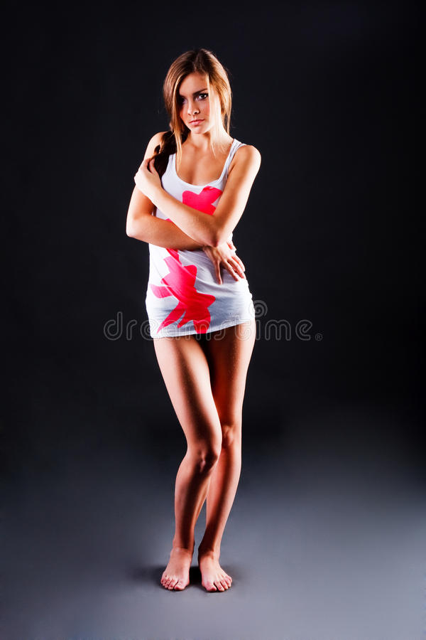 Attractive young girl in t-shirt royalty free stock photo