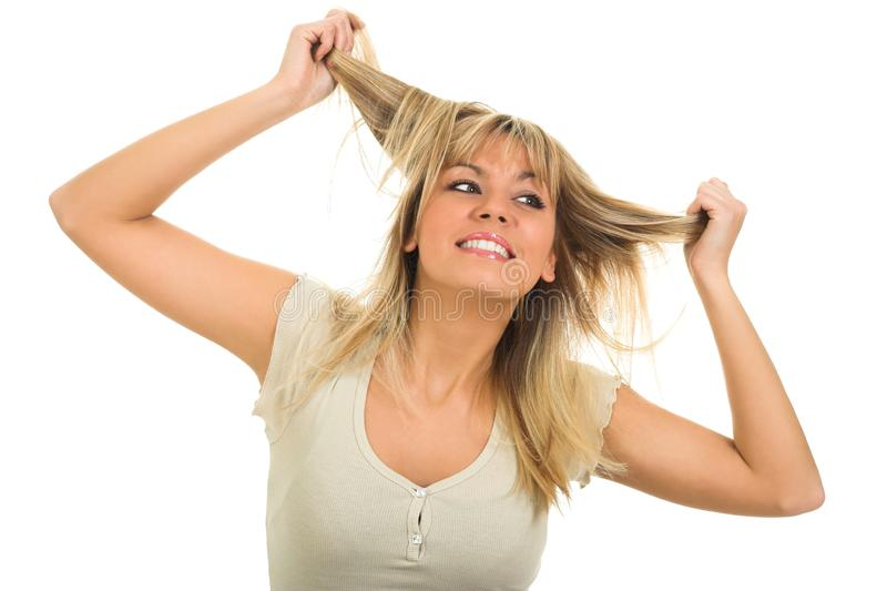 Attractive young girl touching hair and posing royalty free stock photo