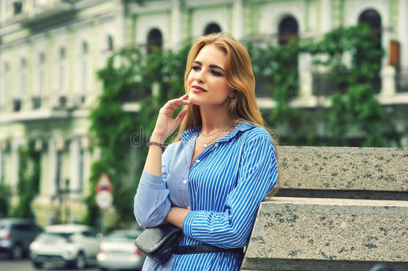 Attractive young, confident girl in town stock photo