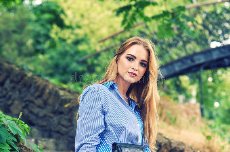 Attractive young, confident girl in town royalty free stock photo