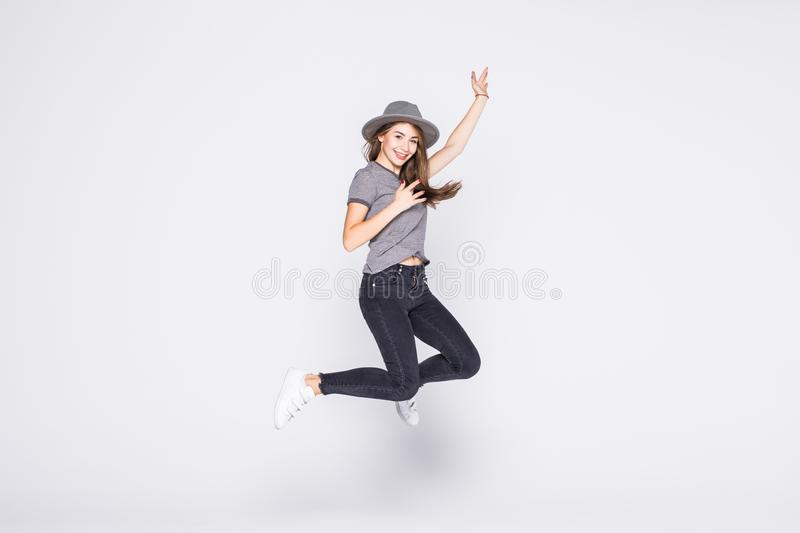 Attractive beautiful young girl wearing casual flying in air isolated over grey background. Attractive young girl wearing casual flying in air isolated over grey royalty free stock image