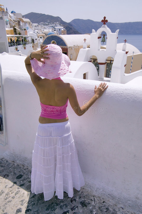 Attractive young Greek woman on the streets of Oia, Santorini stock photo