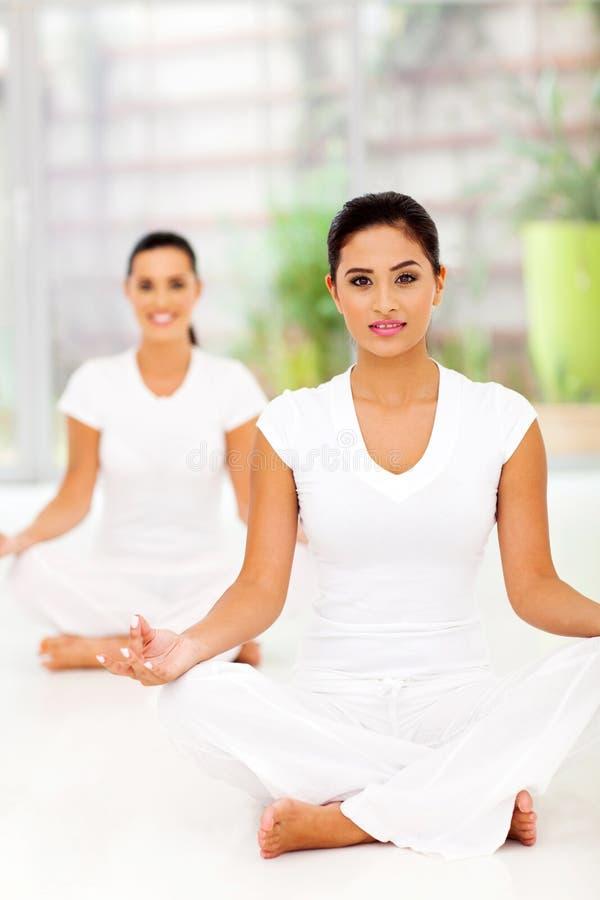Attractive women meditating royalty free stock photos