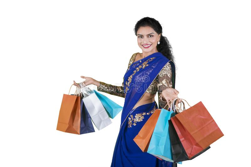 Indian woman posing in studio with shopping bags stock image