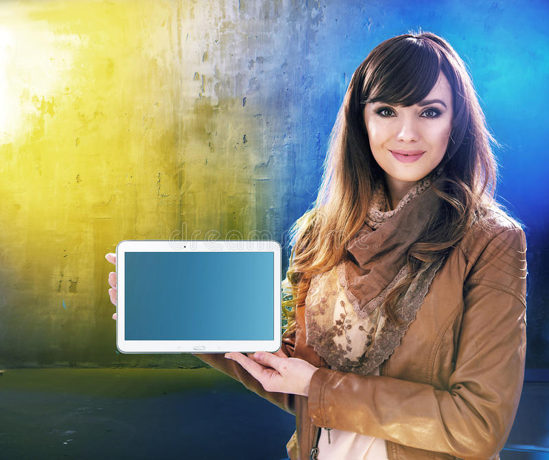 Attractive young lady holding a tablet royalty free stock photos