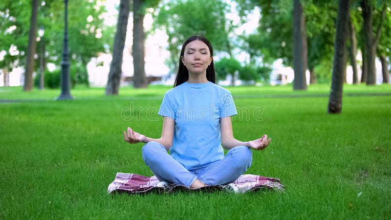 Young Woman Meditating In A Forest. Zen, Meditation ...