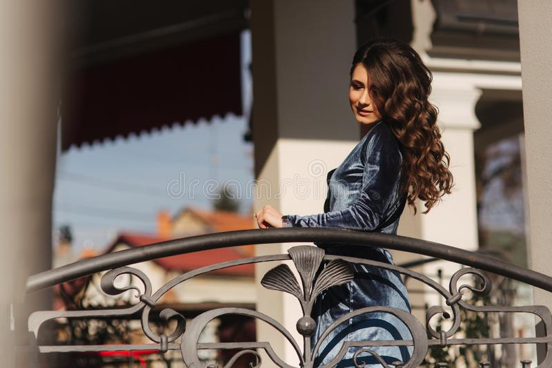 Attractive young lady poses to photographer. Outside. model. In dress stock photography