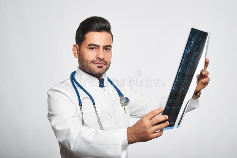 Male doctor posing at studio stock photos