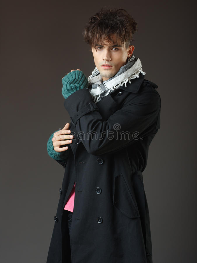 Attractive young male model posing in the studio royalty free stock photography