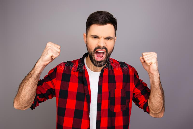 Attractive young man achievement a goal and screaming stock image