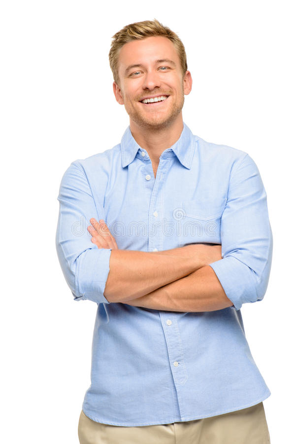 Attractive young man with arms folded on white background. Attractive young man with arms folded smiling stock images