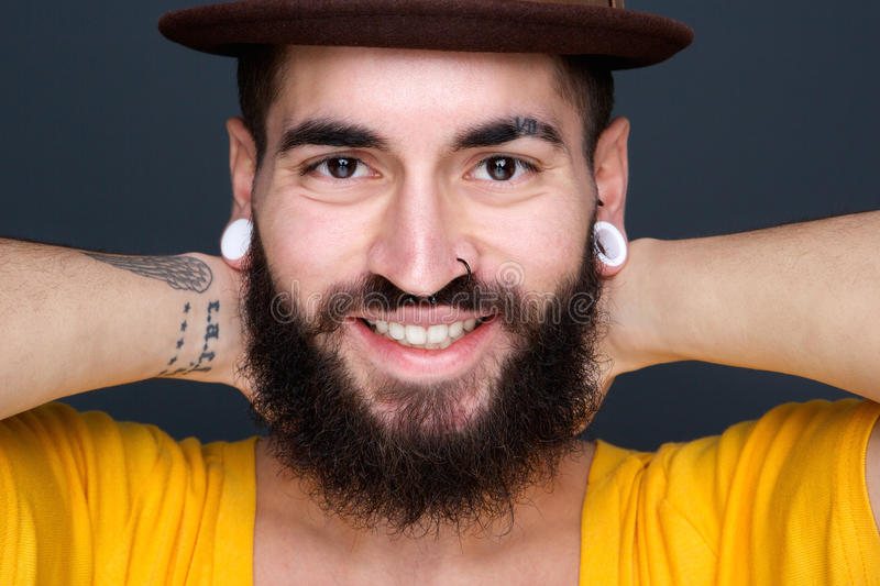 Download Attractive Young Man With Beard Smiling Stock Image - Image of background, laughing: 38659815